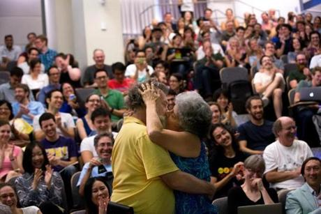 Jim Carey (left) and Rachel Carey (right) kiss during a presentation on research on how kissing affects the immune system at the Ig Nobel awards, which honor goofy scientific research, at MIT in Cambridge.